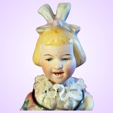 Bisque Doll with molded hair and molded bow