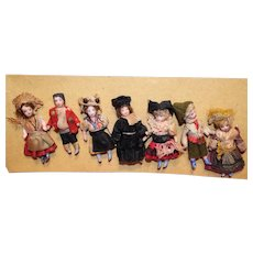 Seven French All Bisque Lilliputian Dolls