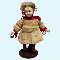 Petite German Bisque Doll in Polka Dot dress