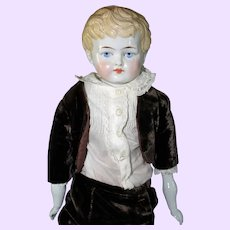Blond China Boy doll in velvet suit