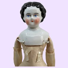 Early China head doll with serene expression