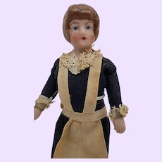 Doll House doll in blue dress