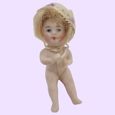 Seated All bisque little doll