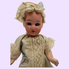 German Bisque 5 1/2  inch Blond curly hair doll
