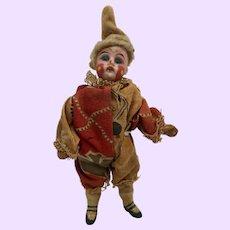 Tiny German bisque clown doll