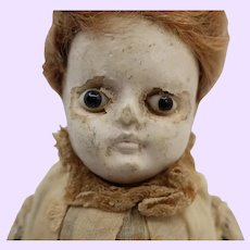 Early Wax over Paper mache with glass eyes