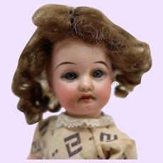 German bisque doll in original clothing