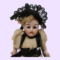Factory original all bisque doll in Traditional clothing