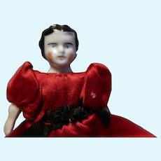 Tiny China doll 1880 in red satin