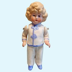 All Bisque Doll in Molded Clothing