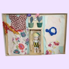 Jean Darling and her sewing outfits in box