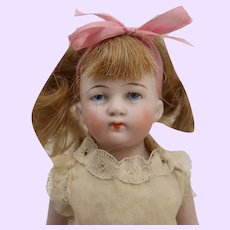 All bisque 6 1/2 inch doll painted eyes