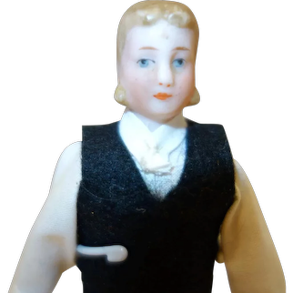 Doll House man with big sideburns