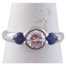 Superb PLATINUM with.60 Carat Brilliant Cut Diamond and  Round Cut SAPPHIRES RING