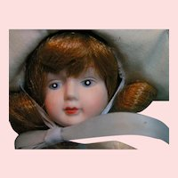 Zasan red head bisque and cloth young girl