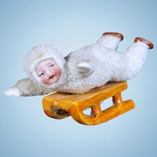 "Antique Snow Baby ""Child on Sled"""
