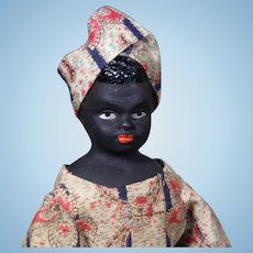"Ebony Complexioned German Bisque Doll with Molded hair. 10 ""."