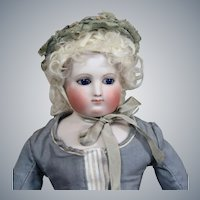Early French Bisque Poupee with Simonne Store Label