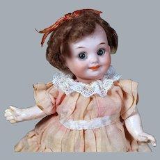 "Impish 6.75"" A.M. #323 Googly Doll In Original Wig, Flounce Dress"