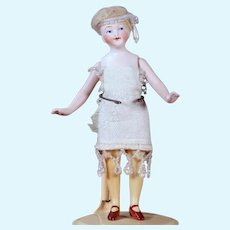 """All Bisque Flapper Doll with Yellow Stockings. 5.5"""""""