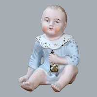 All bisque Baby Figurine with Molded Clothing, 5 inches