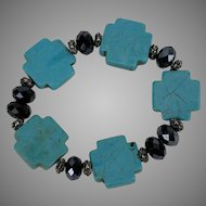 Turquoise and Black Faceted Glass Bead Stretch Bracelet