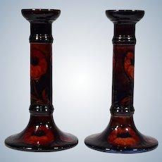 "Pair of Moorcroft Flambe ""Poppy"" Pattern Candlesticks, Circa 1920"