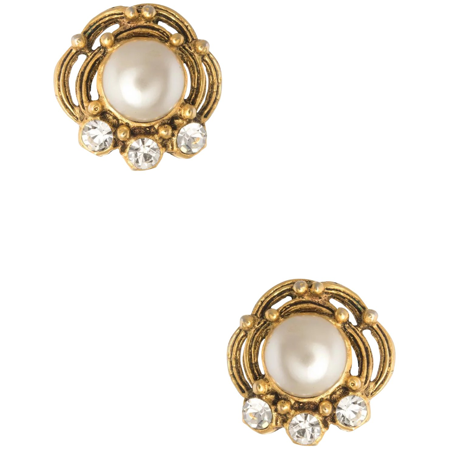 framing a faux pearl centre in a goldtone setting. Faceted borealis crystals 1980/'s clip on Earings