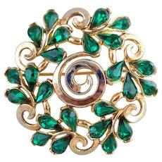 Vintage TRIFARI Green Rhinestone Circle Scroll Pin Festive