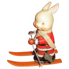 Tin litho wind-up soft rubber Rabbit on skis