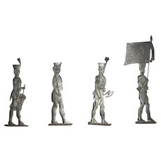 Four lead military toy soldiers. Drum and fife corps in Napoleonic motif and stands