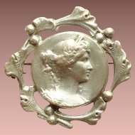 French Art Nouveau Repousse Grecian Revival Lady Face Brooch/Pin with a Ginkgo Frame.