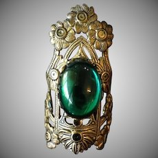 Repousse Brass Flower and Green Cabochon Glass Ring c1900.