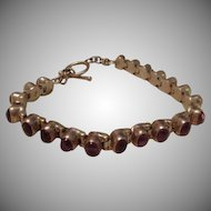 Amethyst and Sterling Silver Etruscan Cabochon Set Tennis Bracelet