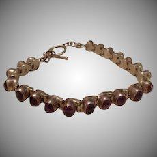 Amethyst and Sterling Silver Etruscan Cabochon Set Tennis Bracelet