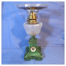 Rare and Unusual Antique Patinated Green Kerosene Lamp with a Clock and Stork Motif in the Base c.1870