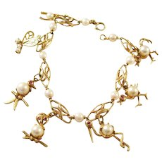 Fabulous Vintage 14kt gold charm bracelet with 7 Whimsical Animal Charms