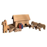Noah's Ark on a piece of fabric with border and a Carved ark and animals
