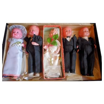 Four celluloid Wedding dolls and one composition Japanese Shirley Temple Doll