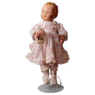 Charming 14 inch Schoenhut Composition doll on the Schoenhut walker body