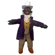 Schoenhut Black Dude with a Purple Coat