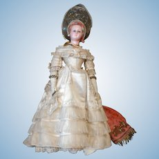 19 the Century wax over papier mache doll