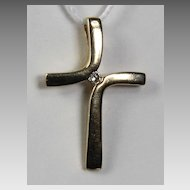 14K Cross with .01 ct.  Diamond