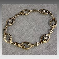 Ladies 10K Gold Oval link Bracelet with Three Diamonds
