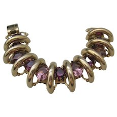 Vintage Gold Tone Articulated Bridge Purple Faceted Rhinestone Bracelet