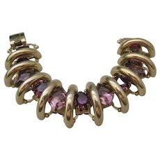 Vintage Gold Tone Articulated Bridge Purple Faceted Rhinestone Bracelet