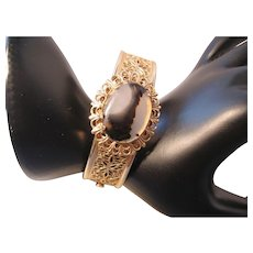 Vintage Open Work Gold Tone Bangle Bracelet with Agate Center Stone