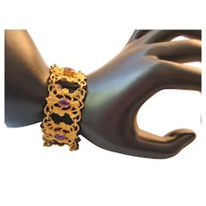 Vintage Art Nouveau Floral Brass and Oval Purple Glass Bracelet