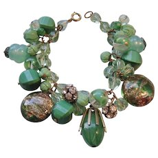 Vintage Shades of Green and Gold tone Crystal, Art Glass and Rhinestone Charm Bracelet