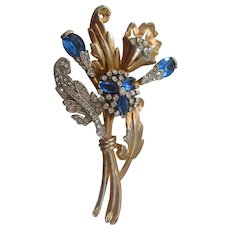 Large Gold Tone Floral Spray with Blue and Clear Rhinestone Brooch-Pin